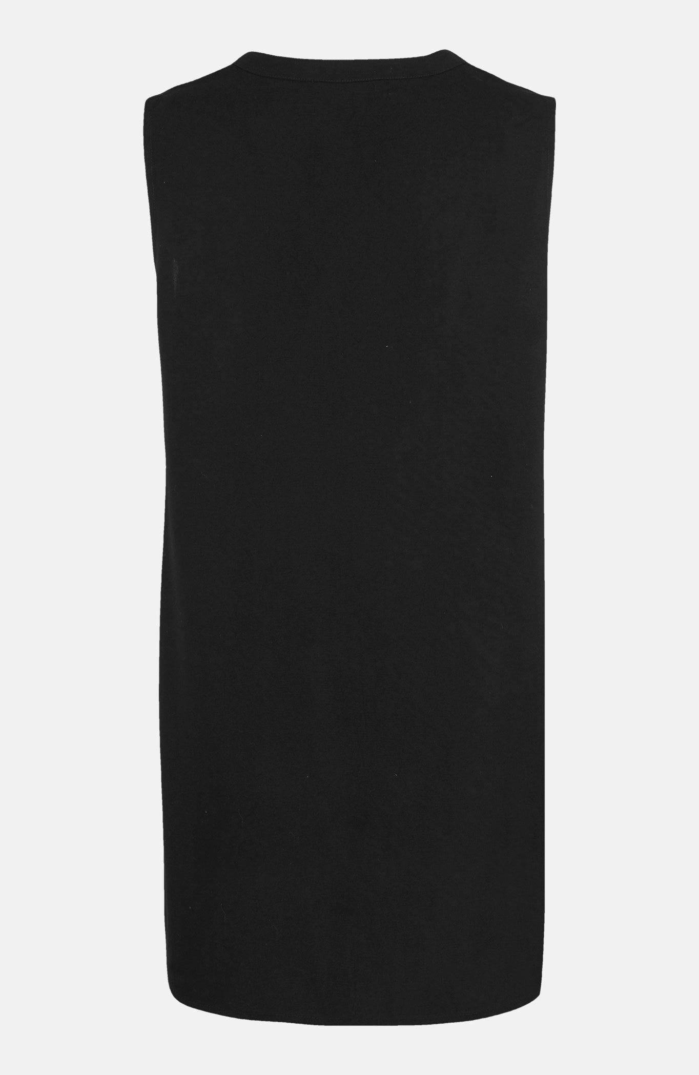 Ermeløs tunika